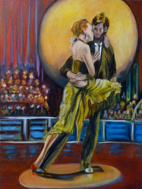 Couple de danseurs de tango argentin sur scène avec lumières et public